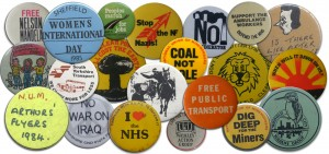Photo of a collection of activism badges.